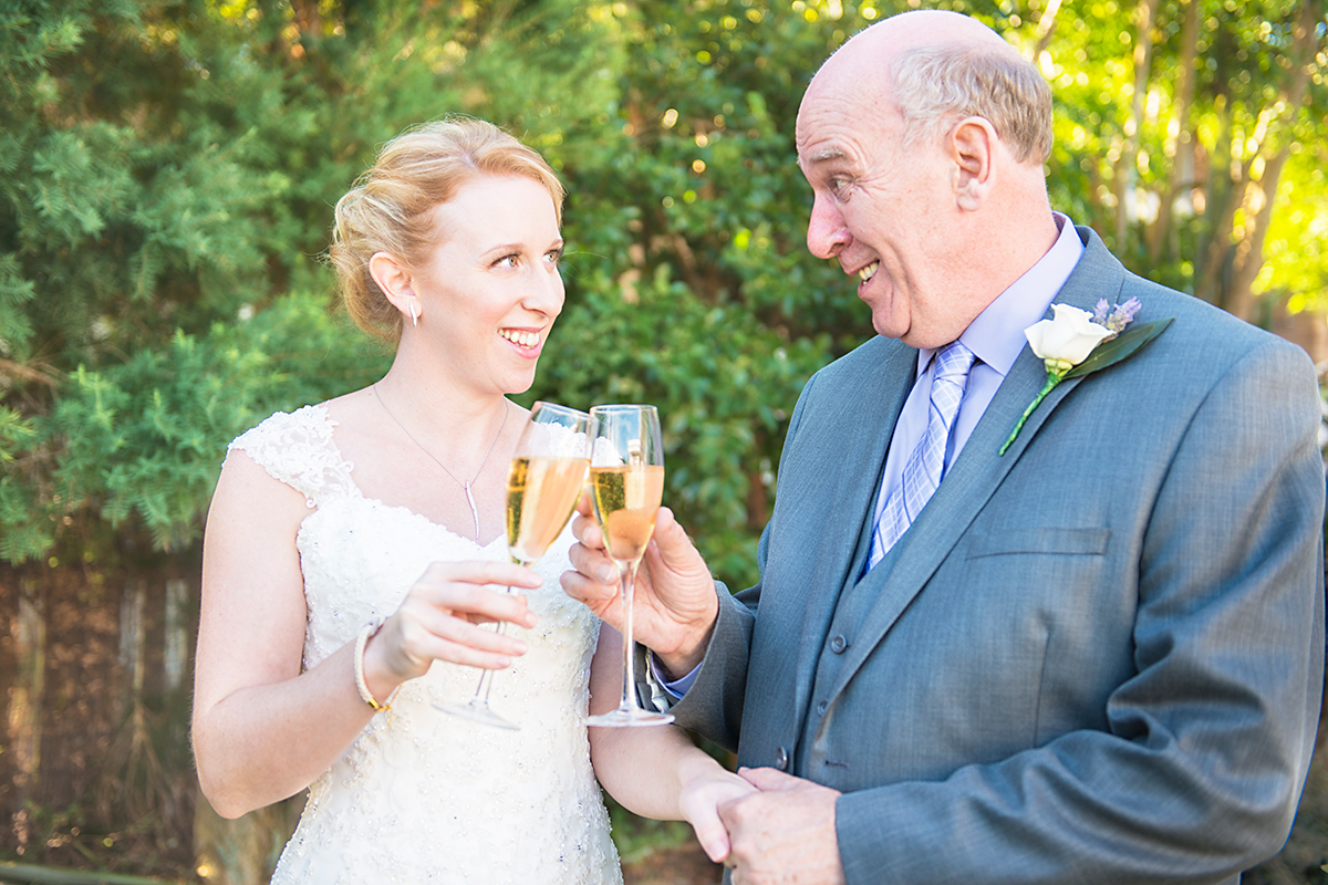 bride and her dad having a glass of champagne before the wedding ceremony NZ